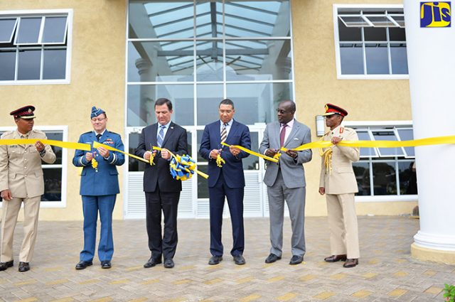 Officials cutting the ribbon at the opening of Jamaica Defence Force's (JDF) Directorate of Training to fight against crime captured by Vision Newspaper Jamaican News