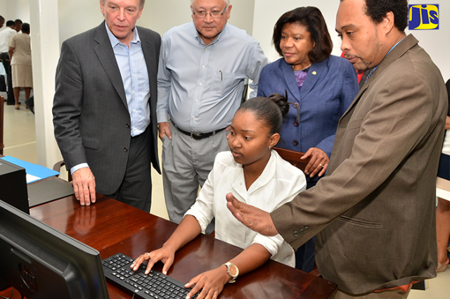 Minister of justice trying out the new CISS system captured by Vision Newspaper Jamaican News