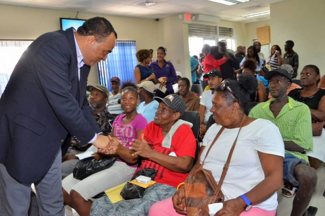 ministry of health greeting patients at pharmacy filling prescriptions captured by Vision Newspaper Caribbean news
