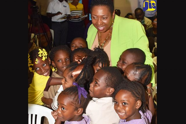 Olivia Grange and children at a sports even captured by Vision newspaper Caribbean news