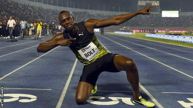 Usain Bolt celebrating his final race in Jamaica captured by Vision Newspaper
